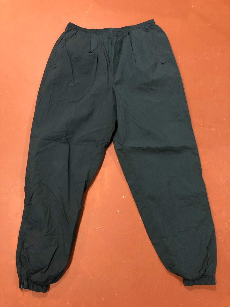6fe442e7ca164 XL 90's Nike track pants men's vintage 1990's green zipper ankles insulated  swishy running jogging basketball