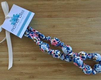 Rifle Paper + Co Rosa Cotton Teething Nursing Necklace | Breastfeeding | Organic Wood Teether | Wood | Natural | Crunchy | Fabric Neckwear |