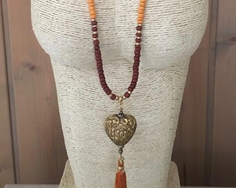 Fancy necklace coconut beads and Tibetan Horn pendant with tassel