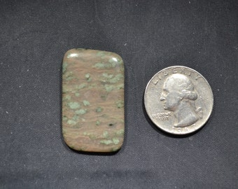 Nunderite free form Cabochon