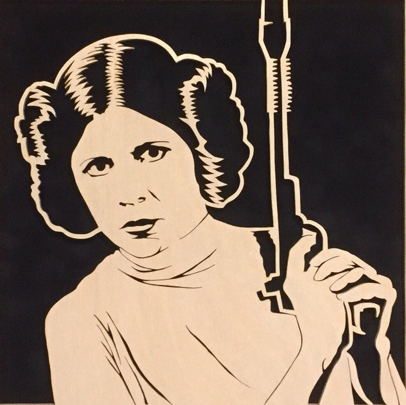 Carrie Fisher as Princess Leia Blaster at the image 0