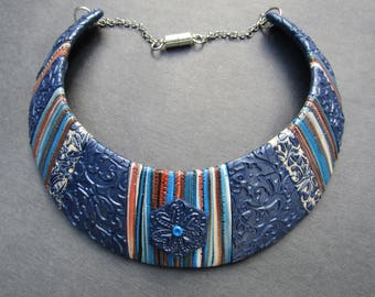 Embossed blue polymer clay bib necklace