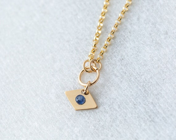 Blue sapphire evil eye gemstone charm necklace in 14k yellow gold fill