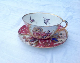Cup and saucer 1887 handpainted
