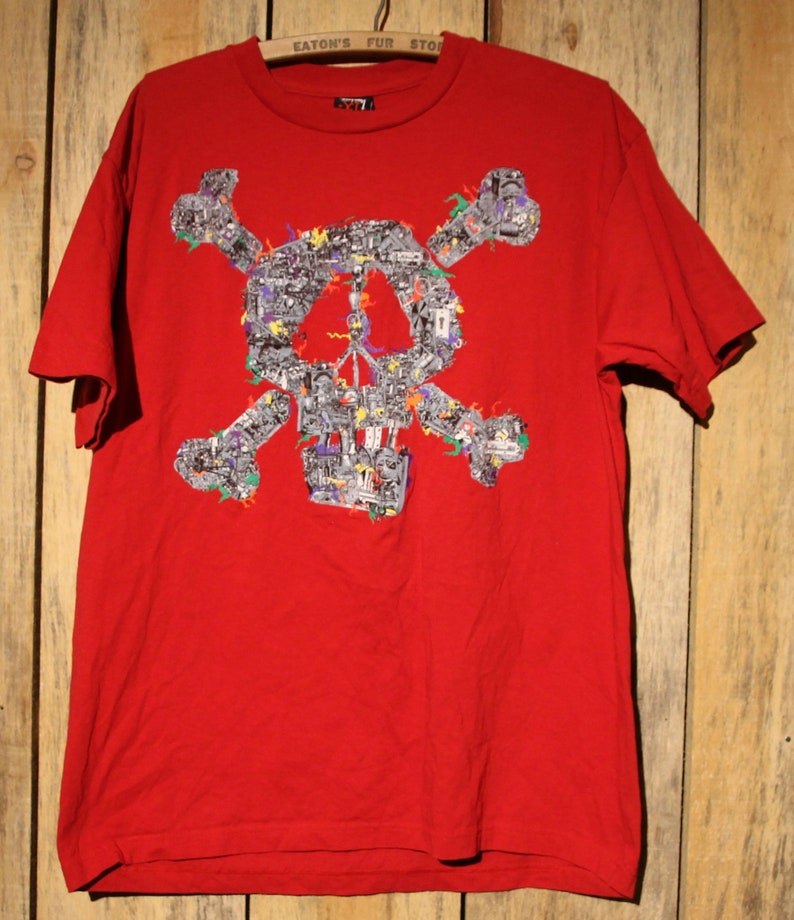 ed79d07a653 Vintage Stussy Red Skull And Crossbones T-Shirt Size XL Rare
