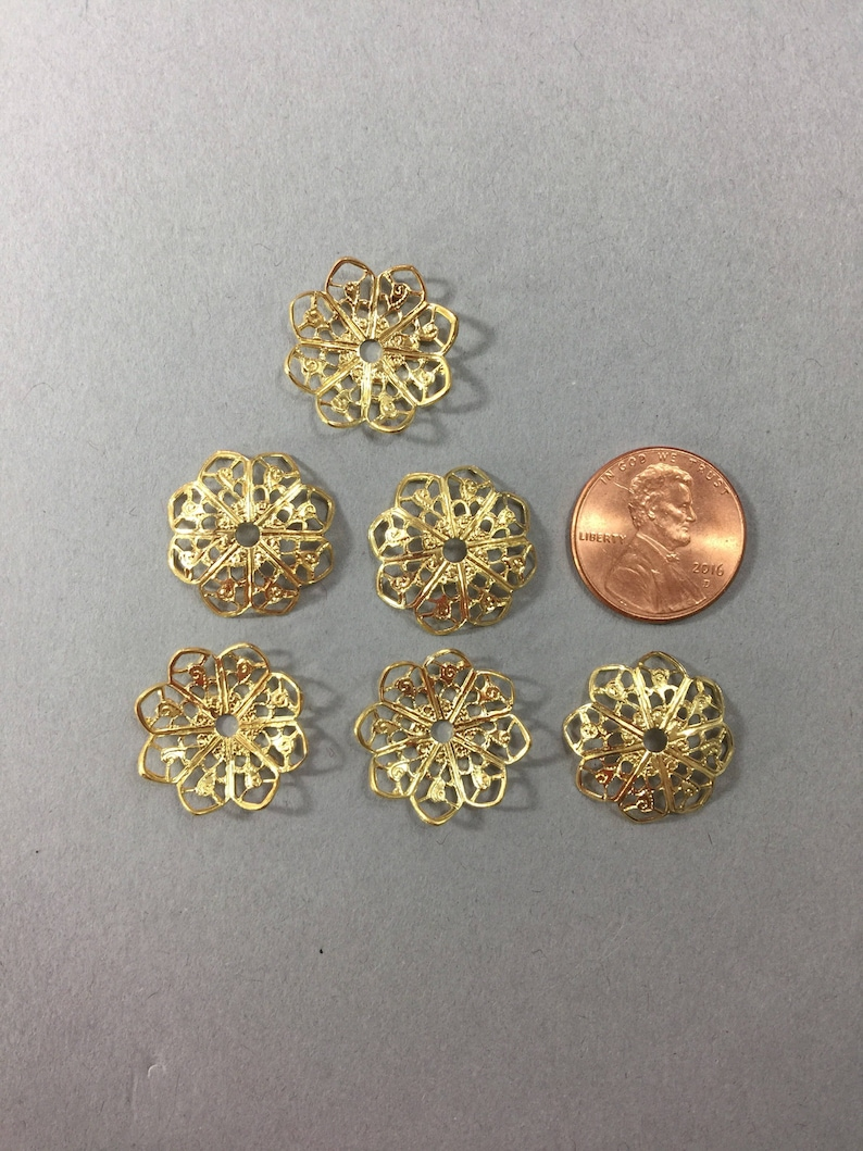 Metal findings NOS 18mm Sold by lots of 12 pieces. Lovely Filigree bead caps