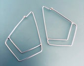 Geometric hoop earrings. ...