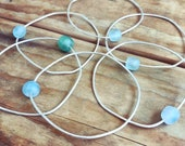 Recycled glass hammered bangle. Blue green glass bead freeform bangle