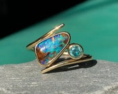 Gold Australian opal ring. Solid 9ct Yellow gold Australian boulder opal and teal moissanite ring