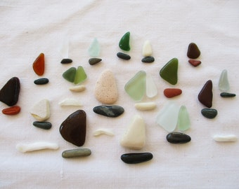 polished sea glass and dishes pottery fragments Pebble art. Supply for mineral board Sailboats Pebbles