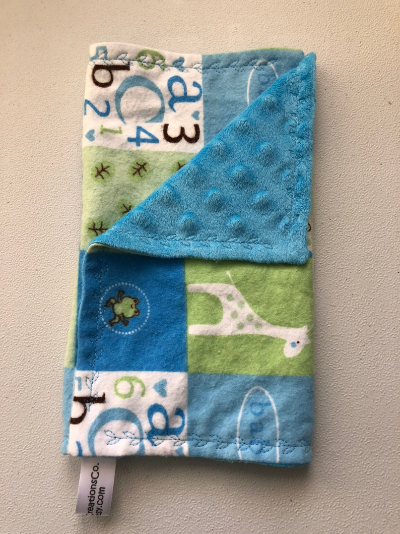 Blue green and white blocks with ABC/'s and giraffes burp clothes and changing pad cover