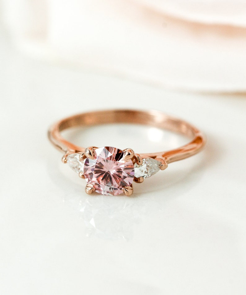8962cf4f252d0 Rose Gold Peach Moissanite Engagement Ring, Round Brilliant Cut Peachy Pink  Moissanite 3 Stone Bridal Ring, Prong Set Trilogy Wedding Ring