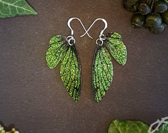 Small training wings. Small forest green sparkle fairy wing earrings on a choice of ear wires.