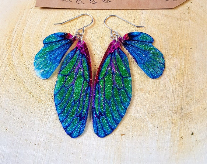 NEW Sparkle Fairy Wing Earrings. Blue/Green iridescent glitter sparkle faerie wings on sterling silver ear wires.