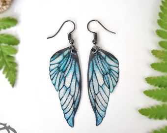 Ice Queen faerie glitter wing earrings. Handmade fantasy faerie wings on a choice of ear wires.