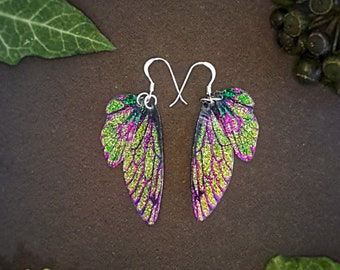 Small training wings. Small green and purple sparkle fairy wing earrings on a choice of ear wires.