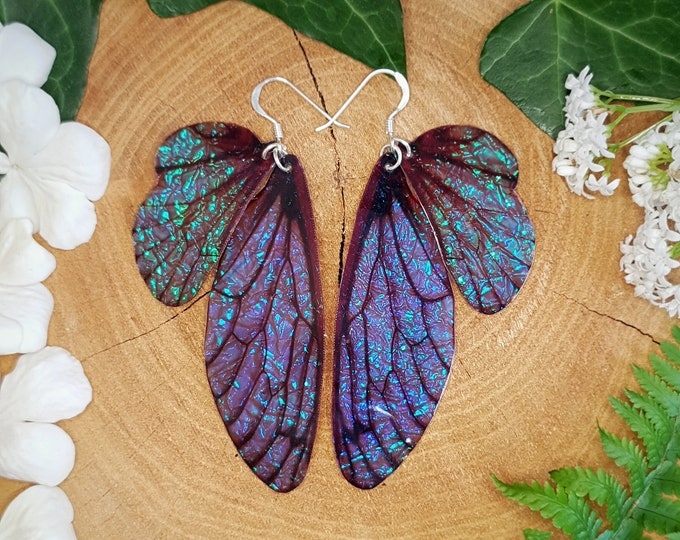 Featured listing image: Large midnight blue fairy wing earrings.