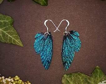 Small training wings. Small Turquoise sparkle fairy wing earrings on a choice of ear wires.