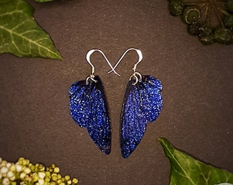Small training wings. Small deep blue sparkle fairy wing earrings on a choice of ear wires.