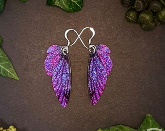 Small training wings. Small purple sparkle fairy wing earrings on a choice of ear wires.