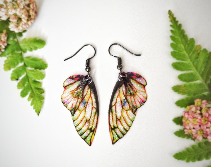 Green forest fairy petal glitter wing earrings.