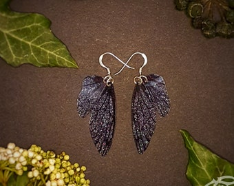 Small training wings. Small black sparkle fairy wing earrings on a choice of ear wires.