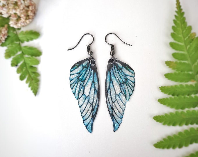 Featured listing image: Ice Queen faerie glitter wing earrings.