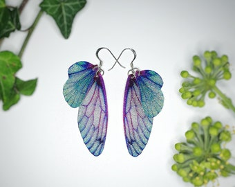 Medium Turquoise And Purple Sparkle Fairy Wing Earrings.