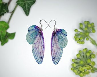 Medium Turquoise And Purple Sparkle Fairy Wing Earrings. Handmade faerie wings on a choice of earwires.
