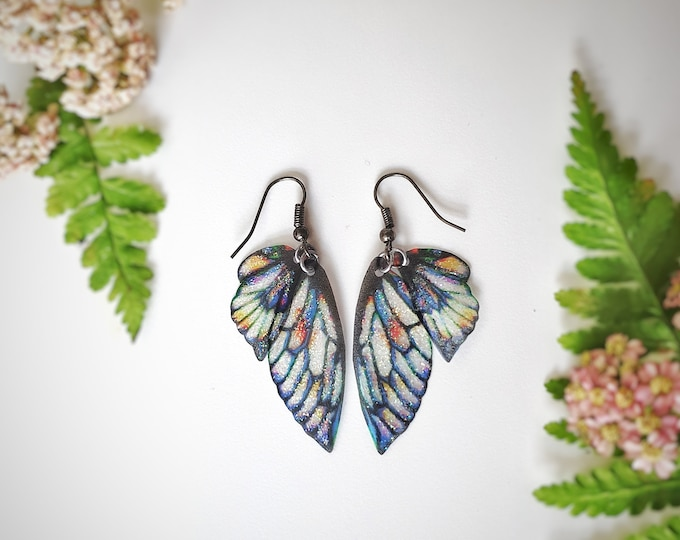 Dark blue petal fairy glitter wing earrings.