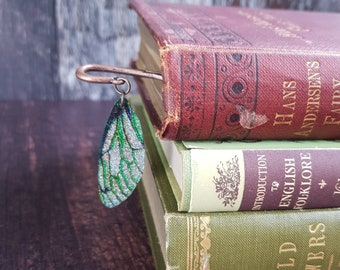 Fairy wing bookmark. Brass metal bookmark with an iridescent green faerie wing charm. Handmade fantasy page marker. Gift for a book lover.