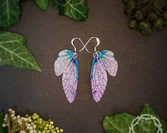 Small training wings. Small pink and turquoise sparkle fairy wing earrings on a choice of ear wires.