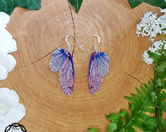 Small training wings. Small pink and blue sparkle fairy wing earrings on a choice of ear wires.