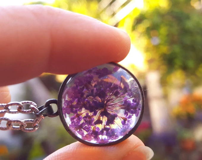 Purple flower Queen Anne's Lace flower terrarium necklace.