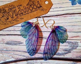 Medium Turquoise And Purple Sparkle Fairy Wing Earrings. Iridescent sparkle Faerie wings on sterling silver ear wires.