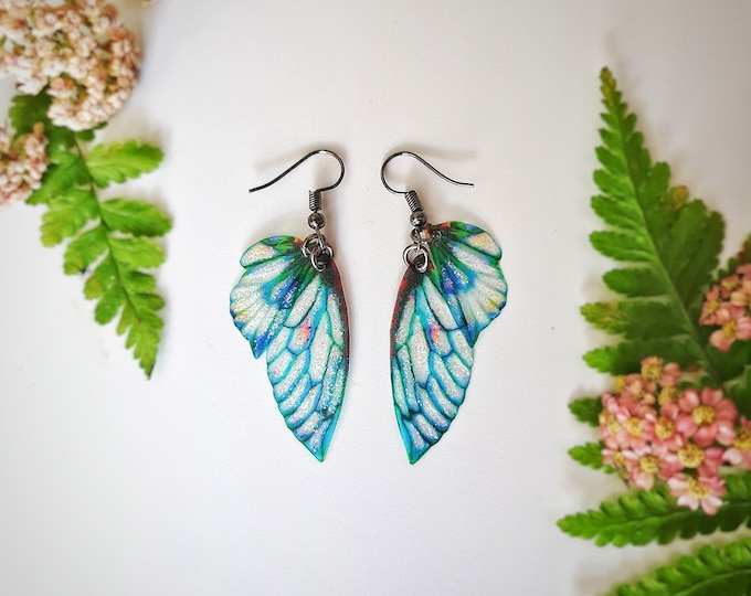 Blue petal fairy wing earrings.