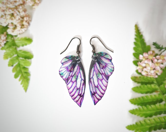 Purple petal fairy glitter wing earrings.