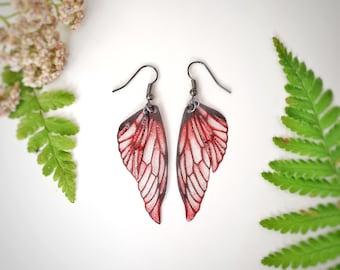 Red lightweight fairy glitter wing earrings.