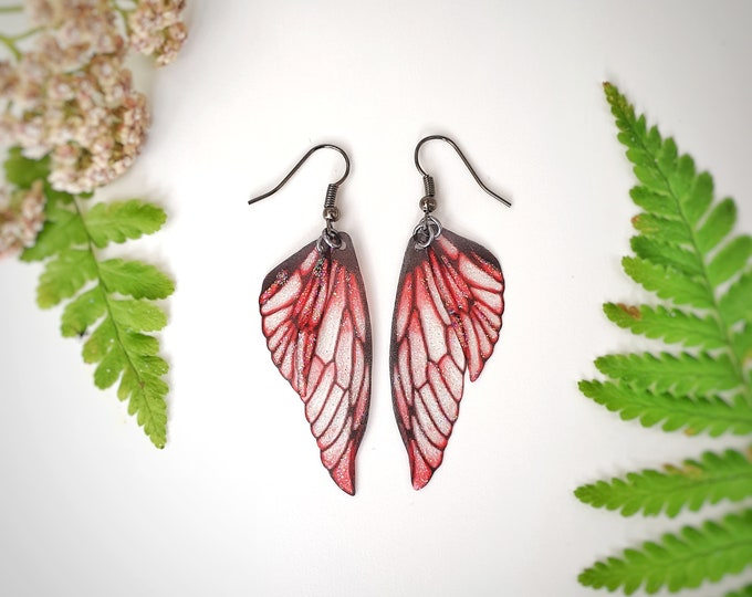 Red lightweight fairy glitter wing earrings.