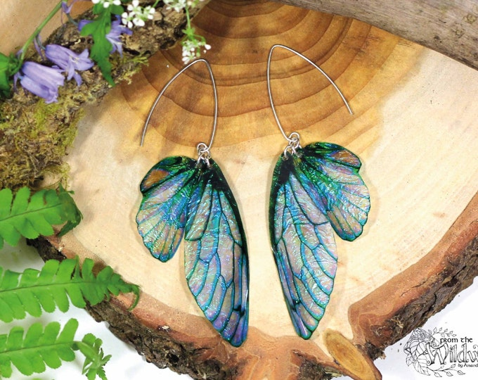 Large pretty blue faerie wing earrings. Iridescent fairy wings on handmade sterling silver ear wires.