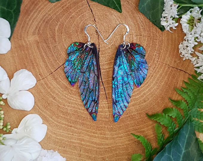 Featured listing image: Opal iridescent fairy wing earrings. Pointed fantasy faerie wings on a choice of earwires.