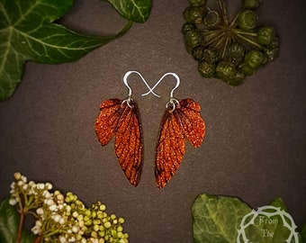 Small training wings. Small bronze sparkle fairy wing earrings on a choice of ear wires.