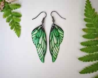Green glitter fairy wing earrings. Enchanted handmade faerie wings on a choice of earwires.