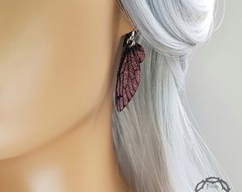 Small training wings. Small dusky pink sparkle fairy wing earrings on a choice of ear wires.
