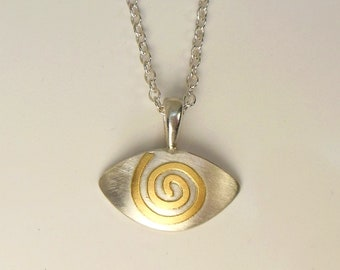Pendant with spiral made of gold, symbolic jewelry, delicate