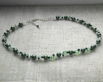 Green pearl and crystal princess style necklace with extension chain.