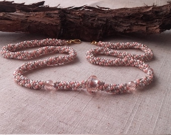 Beautiful pale pink/white/gold kumihimo headed necklace.