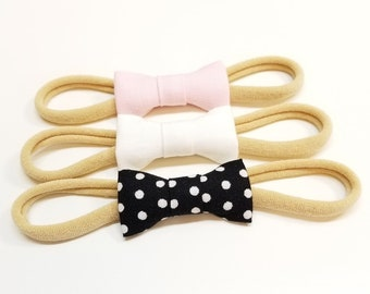 Newborn bows, tiny bows, Itty Bitty Bows, baby girl headbands, pale pink, white and black polka dot