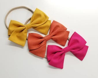 Baby bows Handmade / Must have set Mustard, Burnt Orange and Fuschia / Nylon Headbands or Hair Clips