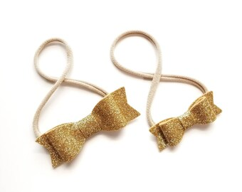 Gold sparkly baby bow, nylon headbands or hair clips